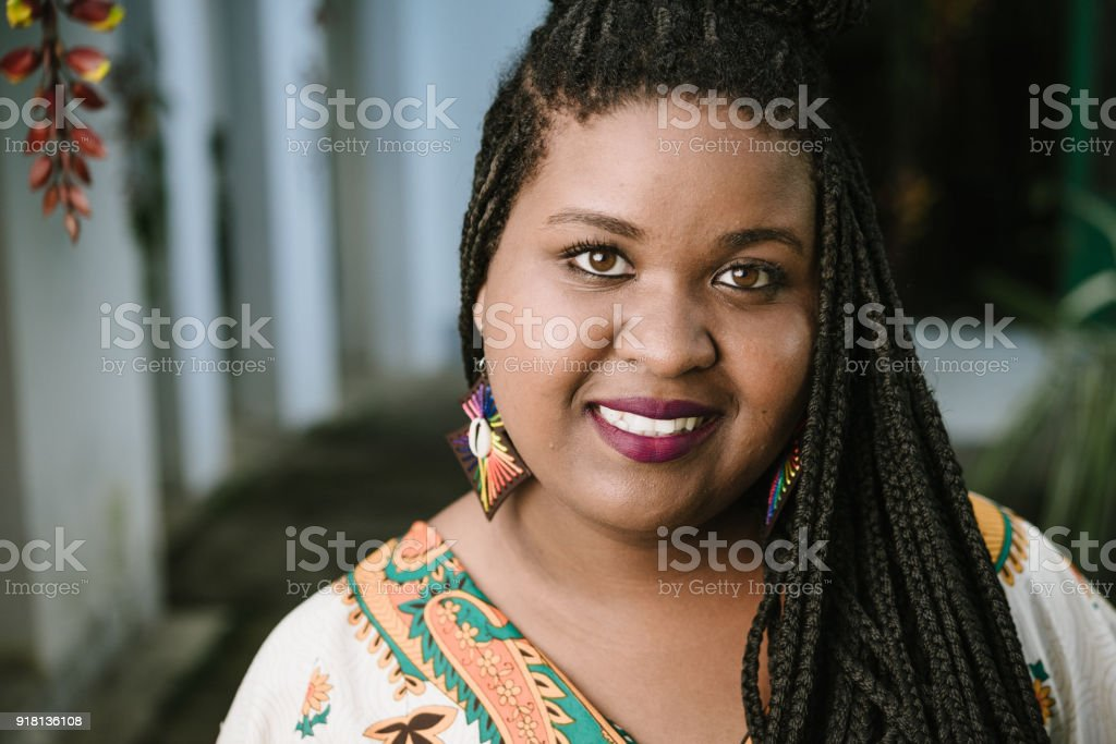 Afro young woman headshot stock photo