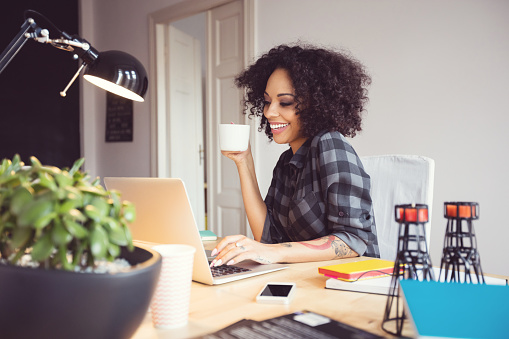 Afro Young Woman In The Home Office Using Laptop Stock Photo - Download Image Now