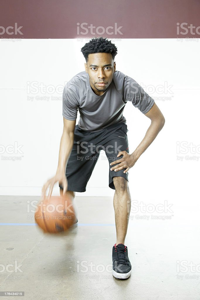 Afro-American 30 years old man playing basketball in a gymnasium royalty-free stock photo