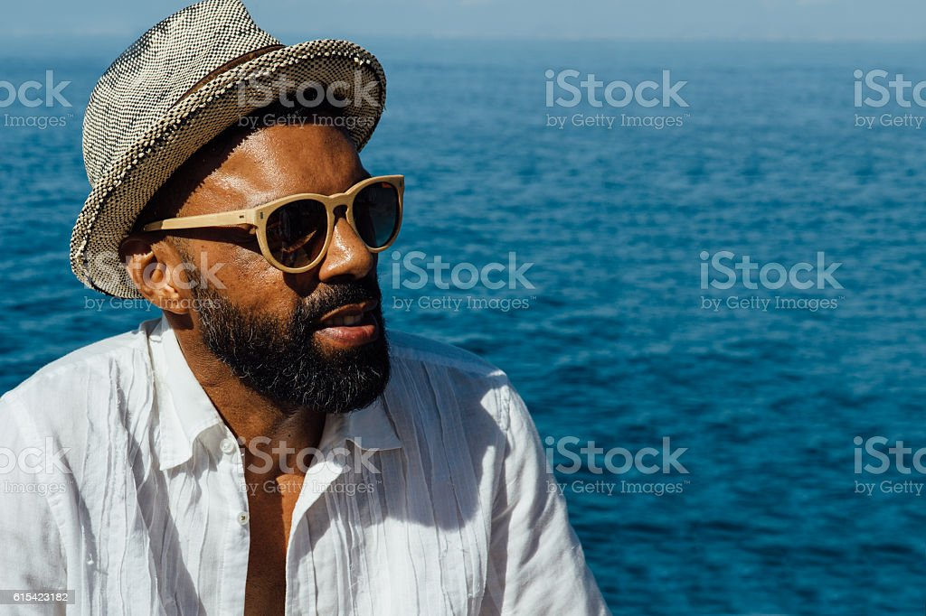 Afro-american bearded man in sunglasses stock photo
