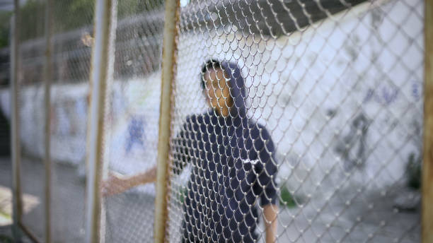 Afroamerican boy behind fence migrant child separated from family picture id1124273172?b=1&k=6&m=1124273172&s=612x612&w=0&h=t d5djstlk2qtq090evuy6282q0tfoiefhd 6ozjuz4=