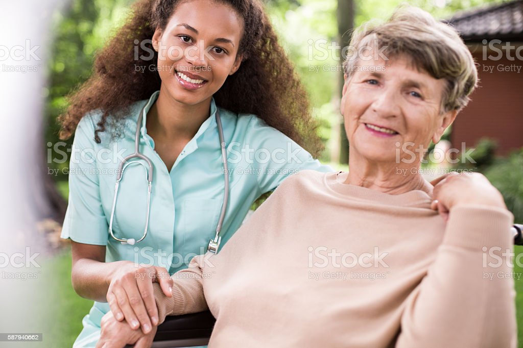 Afroamerican carer and ill patient stock photo