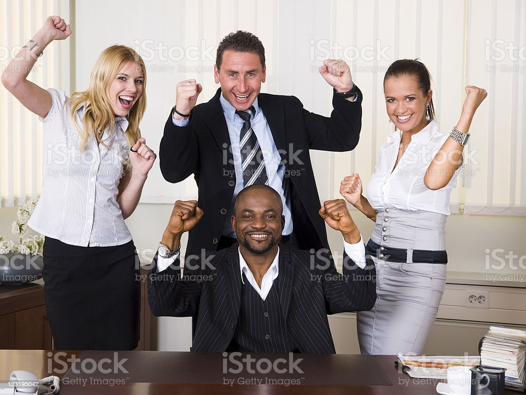 Afroamerican CEO and his team feeling happy and excited royalty-free stock photo