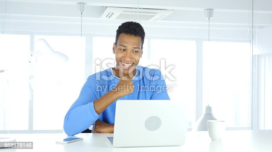 888751614 istock photo Afro-American Man Celebrating Success, Excitement on high Level 858979146