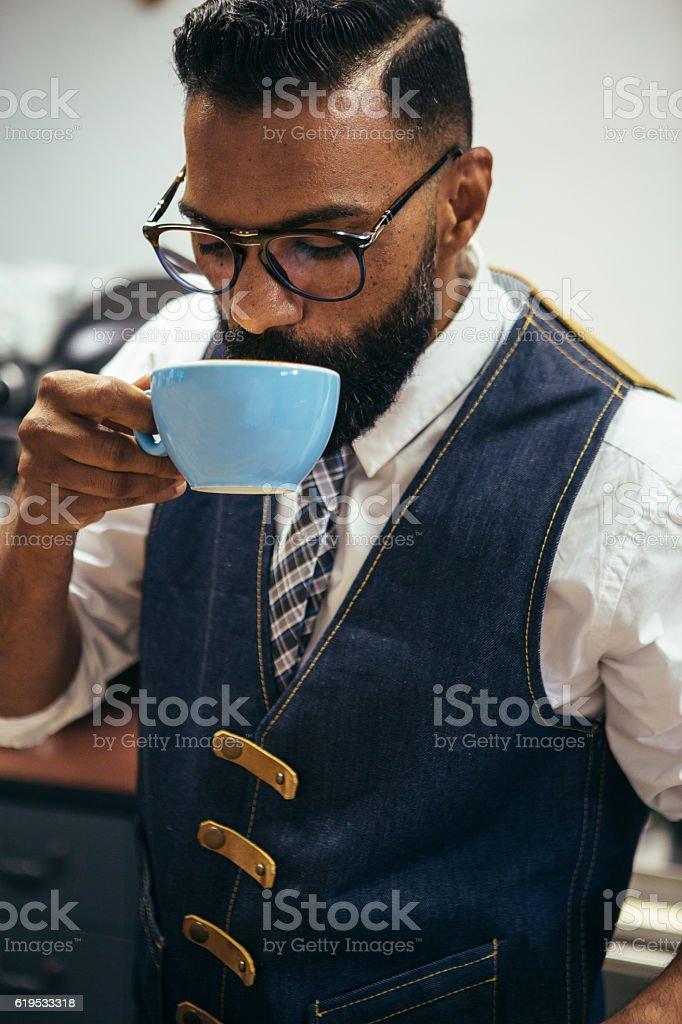 Afro-American man drinking coffee stock photo