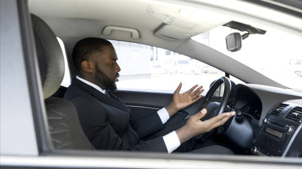 afro-american man getting angry and nervous because of car breakdown, stress - impaired driving stock photos and pictures