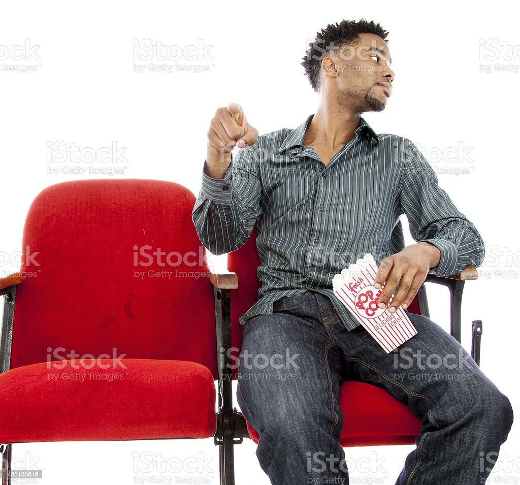 Afro-american man in a theatre isolated on white background royalty-free stock photo