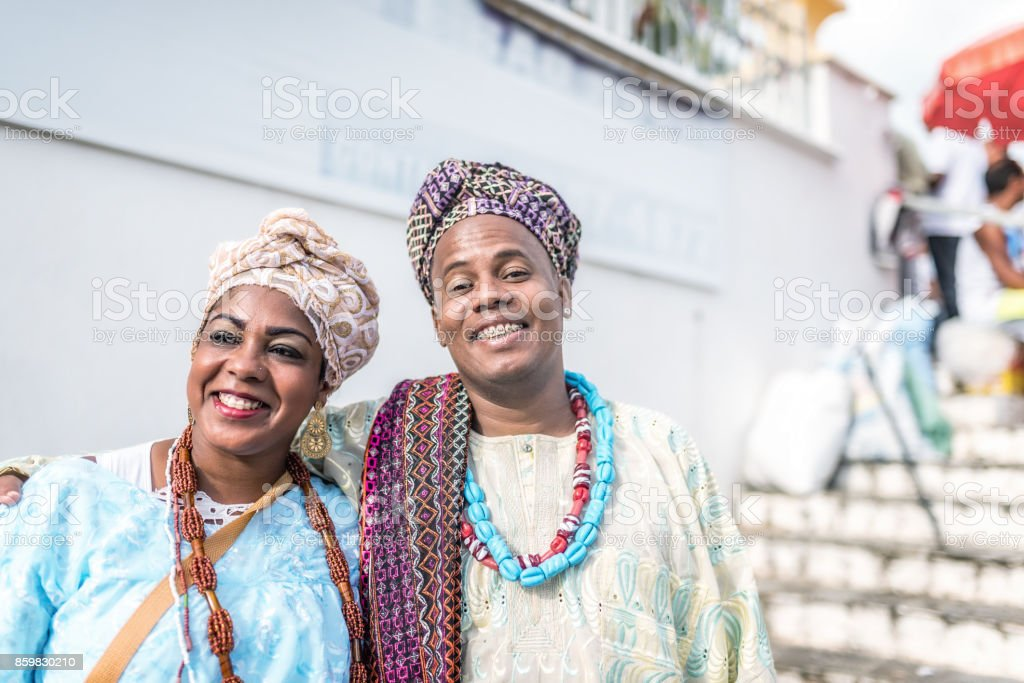 afro-brazilian couple in traditional costume in front of church in Salvador stock photo