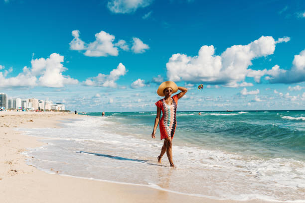 Afro-Caribbean woman enjoys summer at the beach in USA Portrait of beautiful Hispanic woman in bikini at the beach miami beach stock pictures, royalty-free photos & images