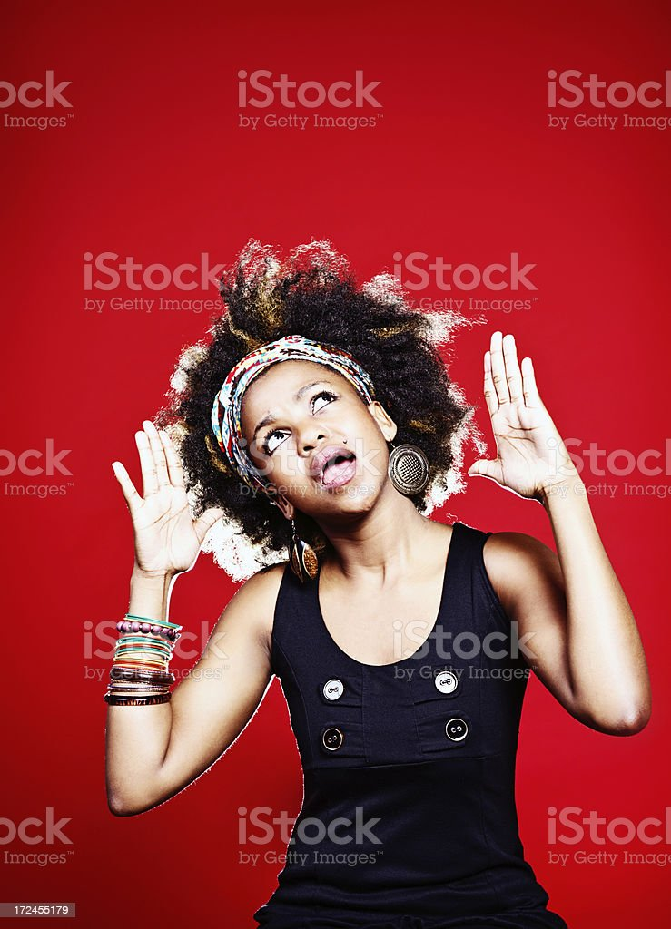 Afro-haired cutie gasps, looking up at space for your message royalty-free stock photo