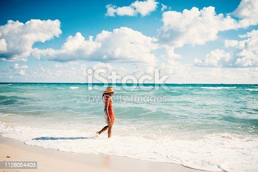 Portrait of beautiful Hispanic woman in bikini at the beach