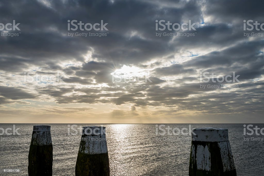 Afsluitdijk with Jetty Poles and Sunrise foto