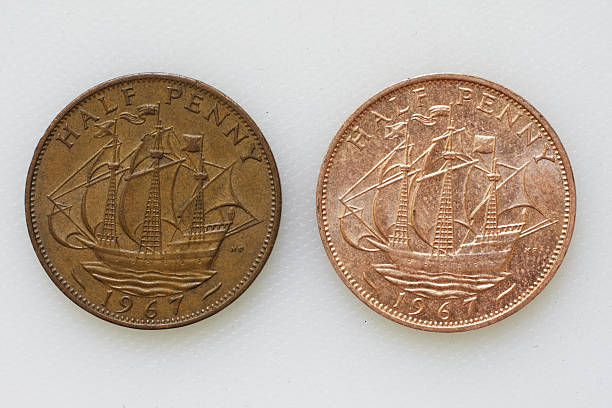 compare british halfpenny 1967 coins after tomato sauce acid test - whiteway money stock photos and pictures