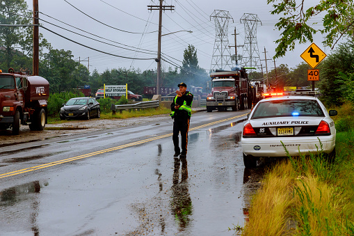 istock 10 SEPTEMBER 2018 NJ USA: A after an accident policeman stopped moving on the road after the accident 1034530580