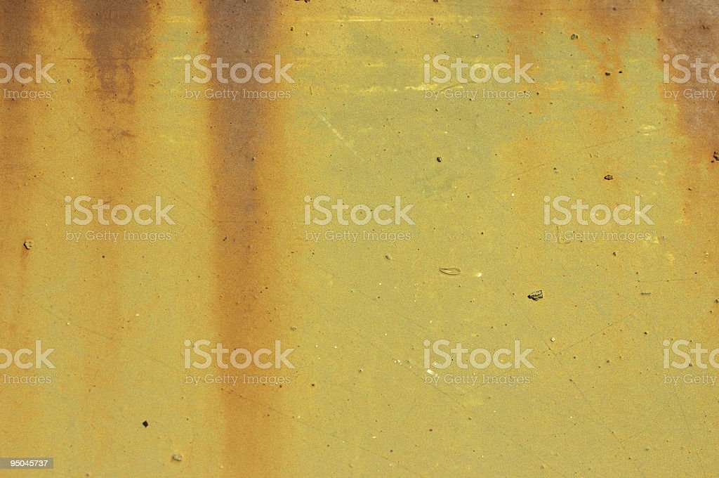Metal background rusty streaks on yellow textured door stock photo