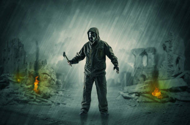 After catastrophe men coming in gas mask and arms Destroyed place after a catastrophe with man in gas mask and weapon on his hand bootes stock pictures, royalty-free photos & images