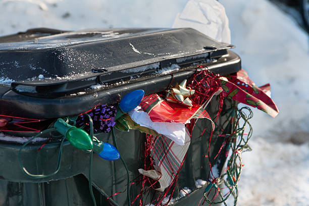 after Christmas trash bin close up stock photo