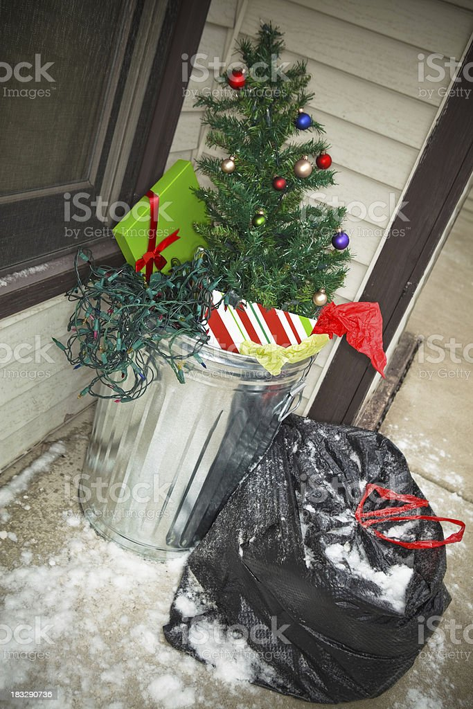 After Christmas - Xmas Tree in the Trash royalty-free stock photo
