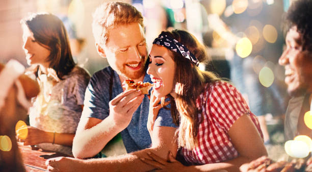 After party food time. Young couple eating pizza after party. food festival stock pictures, royalty-free photos & images