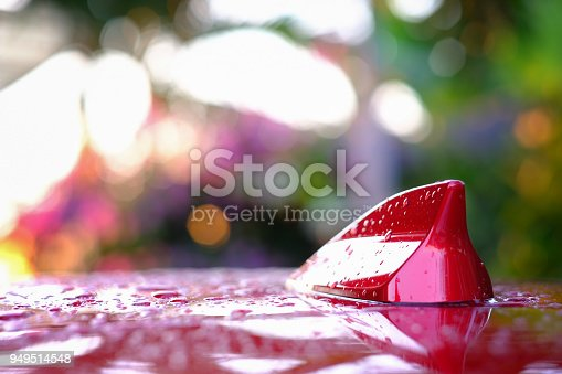 881639308istockphoto After rain GPS antenna shark fin shape on a roof of car for radio navigation system. outdoor car radio antenna, transport concept automotive 949514548