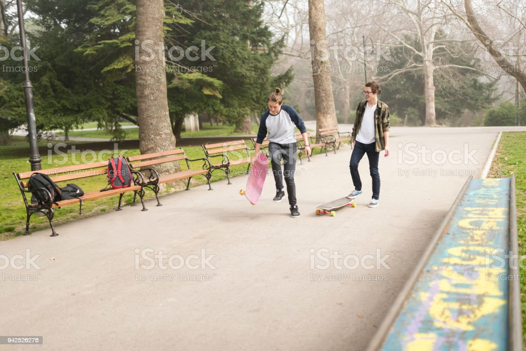 After school - skateboarding with friends stock photo