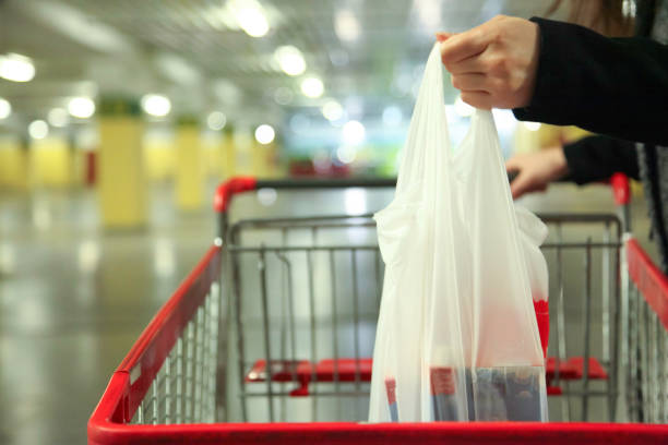 After shopping in the supermarket Serbia, Paying, Adult, Adults Only, Budget, Supermarket, Receipt plastic bag stock pictures, royalty-free photos & images