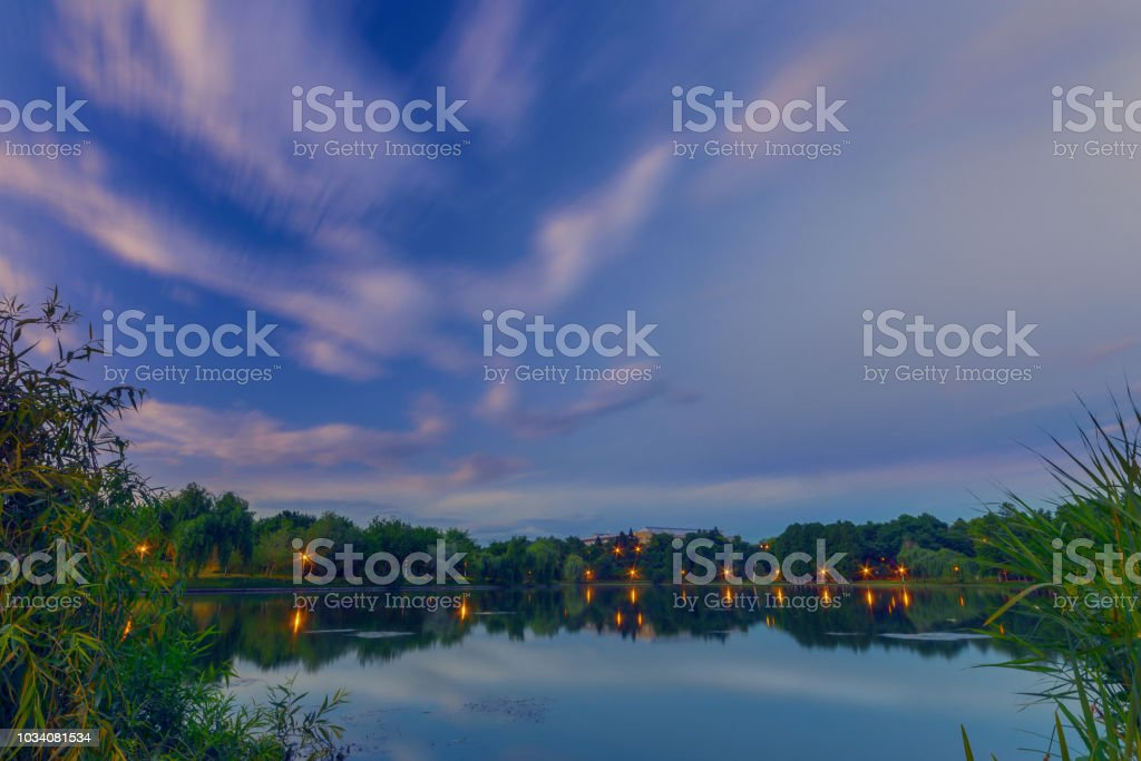 After sunset scene in the park with some clouds stock photo