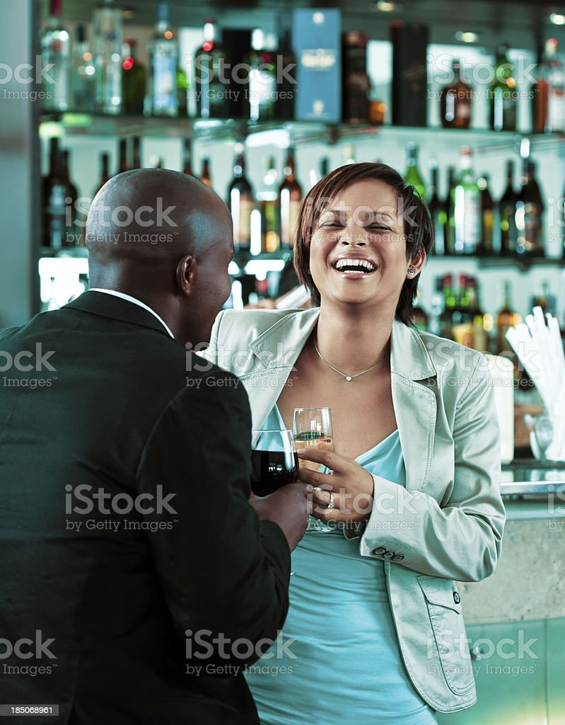 After work Young woman and man having fun over the wine in the pub. Adult Stock Photo