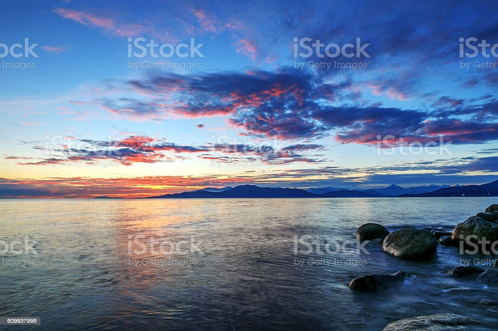 afterglow of sunset over the sea stock photo
