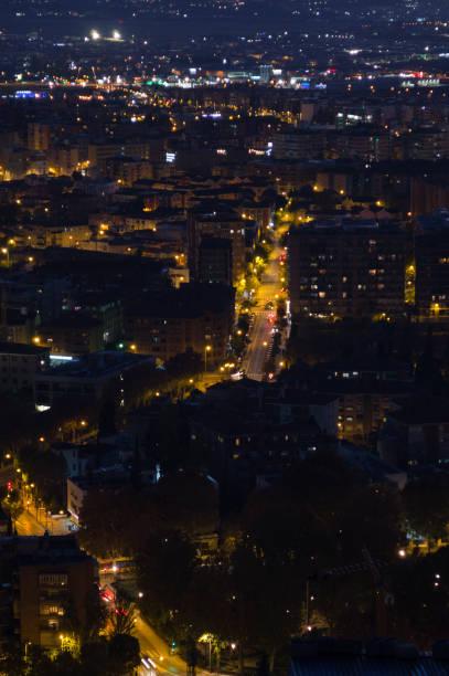 Afterglow with Cityscape and Mountains at Mirador del Barranco del Abogado Lookout in Granada, Spain stock photo