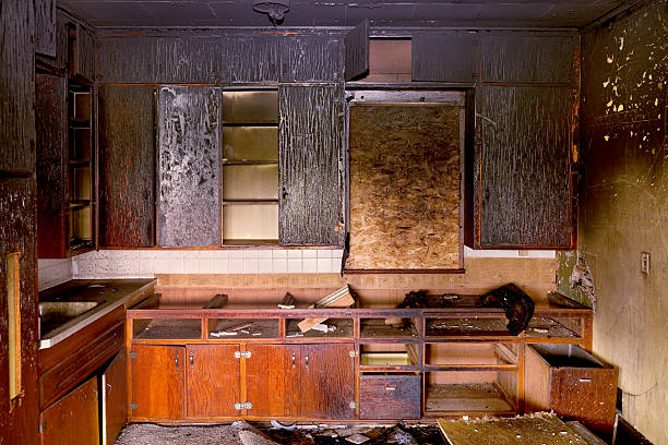 Aftermath: Charred Remains of Kitchen Destroyed by Fire stock photo