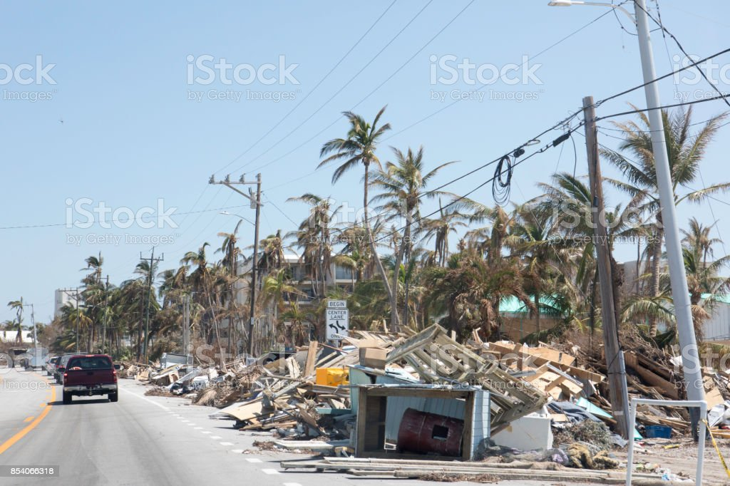 Aftermath of hurricane in Florida Keys leaves piles of trash and debris to be cleaned up stock photo