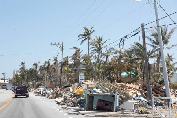 aftermath of hurricane in florida keys leaves piles of trash and debris to be cleaned up - natural disaster stock pictures, royalty-free photos & images