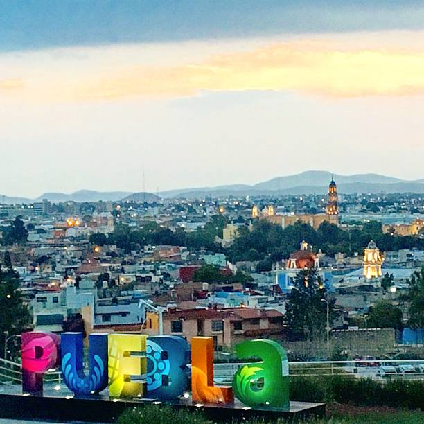 Afternoon at Puebla, Mexico This landscape of Puebla City in Mexico combines ancient history with modern architecture  puebla state stock pictures, royalty-free photos & images