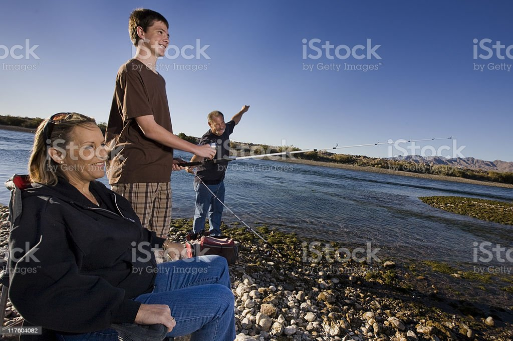 Afternoon fishing with mom dad and son royalty-free stock photo