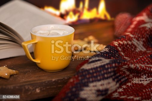 cup of hot cocoa on a background of fire