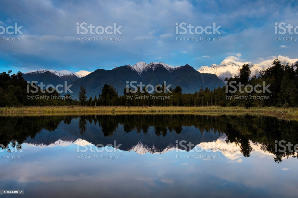 Afternoon Light At Lake Matheson In New Zealand stock photo