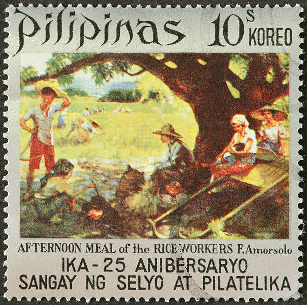 Afternoon meal of the Rice Workers Philippines stamp stock photo