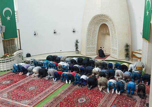 Afternoon prayer in mosque stock photo