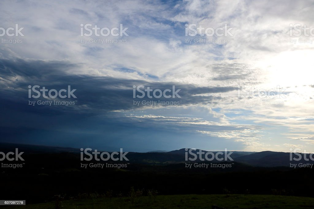 Afternoon Storm Moving Across Country Hills Landscape stock photo
