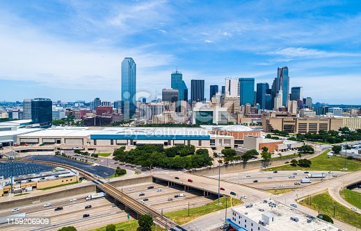 Aerial Drone view Afternoon Sunny day in Dallas Texas overlooking Skyline Cityscape Downtown towers urban concrete 2019