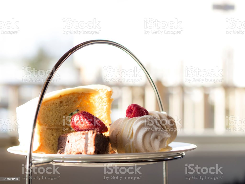 Afternoon Tea close up of cake, brownie, merengue and strawberry stock photo