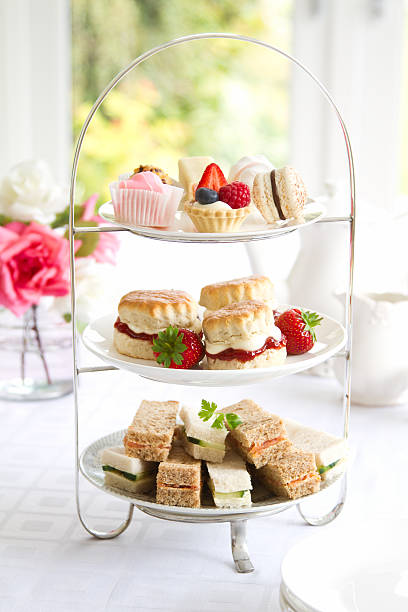 Afternoon tea Traditional afternoon tea served with scones cakestand stock pictures, royalty-free photos & images