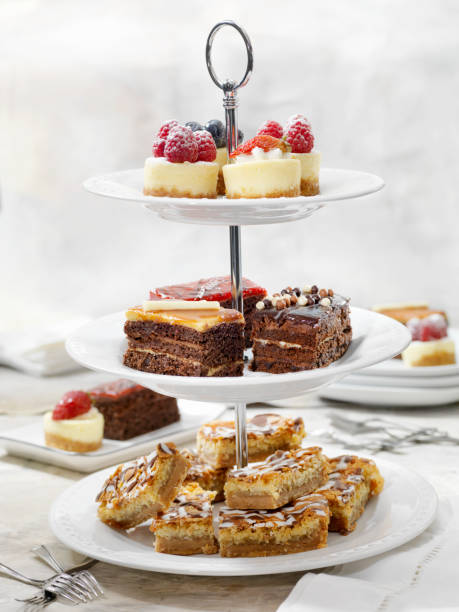 Afternoon Tea Three Tier Stand of Desserts Afternoon Tea Three Tier Stand of Desserts cakestand stock pictures, royalty-free photos & images