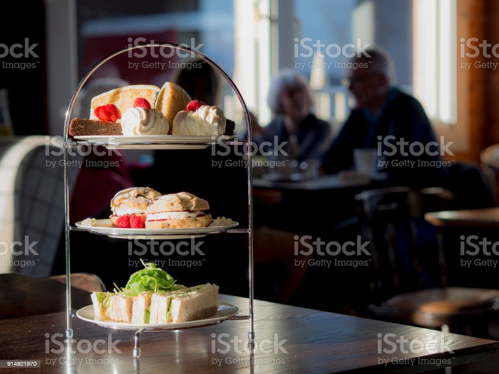 Afternoon Tea with people in the background. stock photo