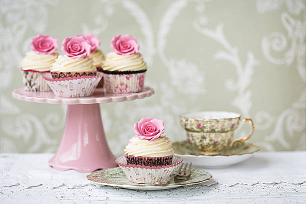 Afternoon tea with rose cupcakes stock photo