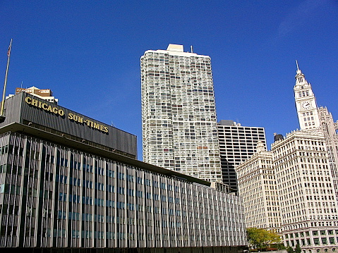 Afternoon view toward old Sun-Times Building, Wrigley Building clock tower