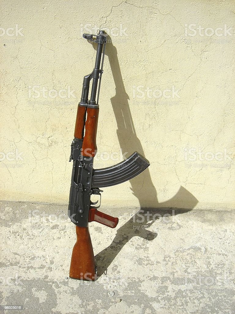 AK-47 against a wall royalty-free stock photo
