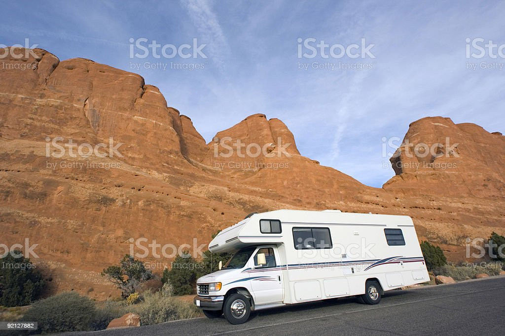 RV against red rock formation, Utah. royalty-free stock photo