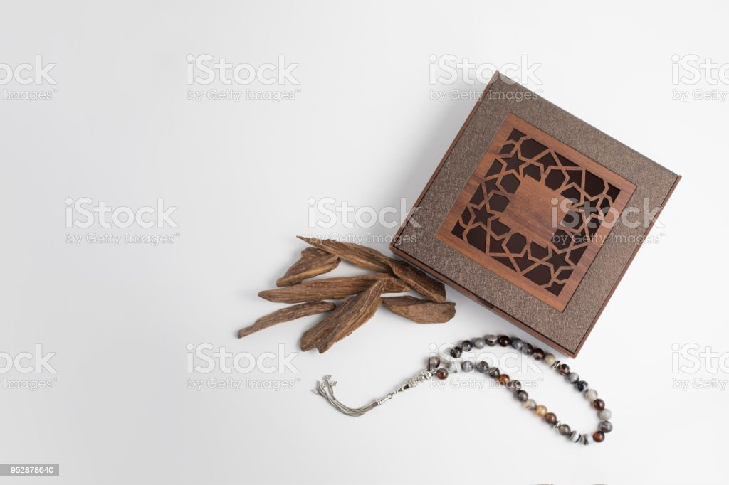 Agarwood, incense Chips and rosary beads around wooden box stock photo